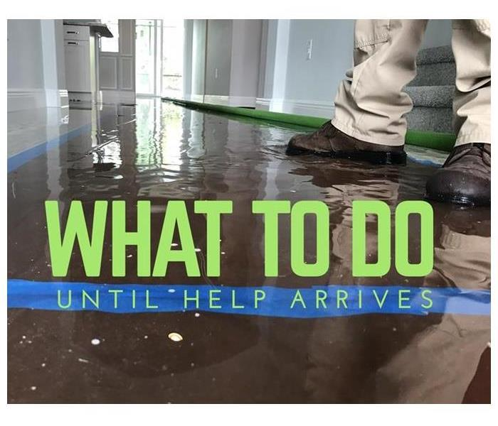 This photo shows an example of a water damage inside a home as water pools on the wooden floors.