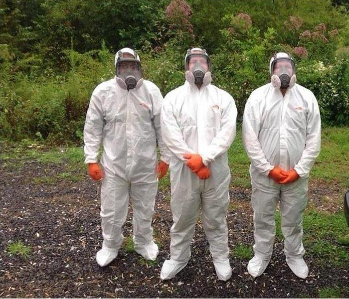 3 SERVPRO professionals wearing protective gear necessary for biohazard situations.